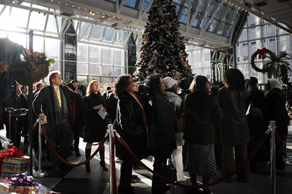 20140106 Peduto meet greet People line up to take a photo with newly sworn-in mayor Bill Peduto during a meet-and-greet Monday at the Wintergarden at PPG Place.