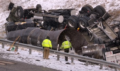 20140106dsFatalLocal01 Investigators were on the scene of a fatal accident Monday on the Parkway West. A tractor-trailer carrying coils of steel and an SUV collided on the outbound Parkway West near Montour Run Road in Moon.