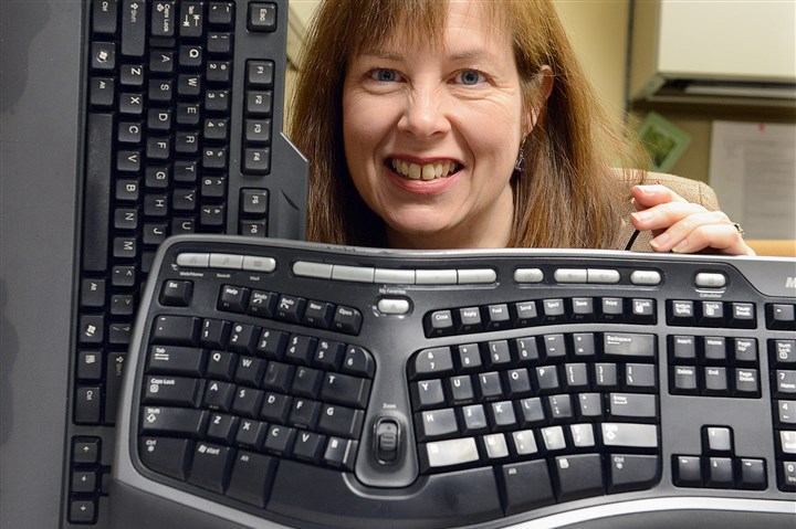 20140102radKeyboardResearch.1.jpg Pitt researcher Nancy Baker found no real difference between a sculpted computer keyboard, right, and a more traditional flat keyboard when it comes to ergonomics.