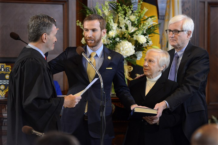 Gilman sworn in to City Council Dan Gilman, standing between his parents, right, and Judge Hugh McGough, is sworn in for his first term on Pittsburgh City Council on Monday. Mr. Gilman represents District 8 in the East End.