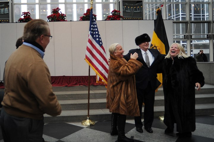 20140106 Peduto meet greet twin sisters Twin sisters Diane, left, and Aldona Zilinskas, 62, of Shadyside laugh as newly sworn-in mayor Bill Peduto tries on one of their hats during a meet-and-greet Monday at the Wintergarden at PPG Place.