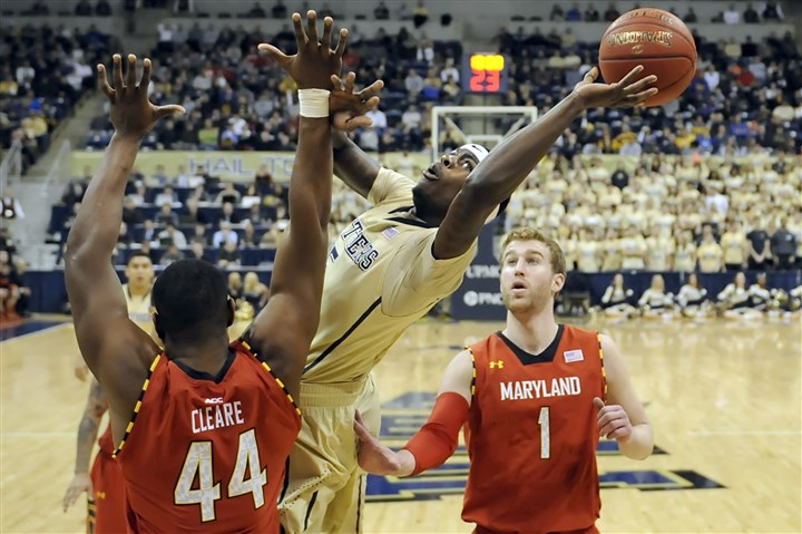 pitt0108 Pitt reserve Durand Johnson draws a foul from Maryland's Shaquille Cleare in the second half at the Petersen Events Center Monday night.