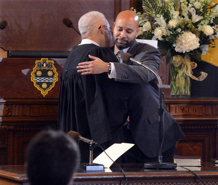 201416RARLOCALCOUNCIL5-6 Pittsburgh Councilman R. Daniel Lavelle hugs Judge Joseph Williams after being sworn for a new term on Monday. Mr. Lavelle represents District 6.