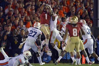 BCS Championship Football Florida State's Kelvin Benjamin catches a touchdown pass with 13 seconds left to lift the Seminoles to a 34-31 victory over Auburn.