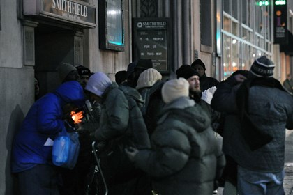 Warming center 1 People line up last night in front of the Smithfield United Church waiting for a shelter to open because of the extreme cold temperatures.