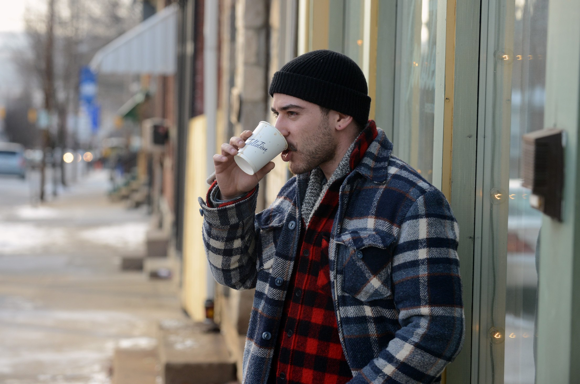 Daniel Gurwin of Lawrenceville Daniel Gurwin of Lawrenceville drinks coffee outside Constellation Coffee in Bloomfield on Penn Avenue.
