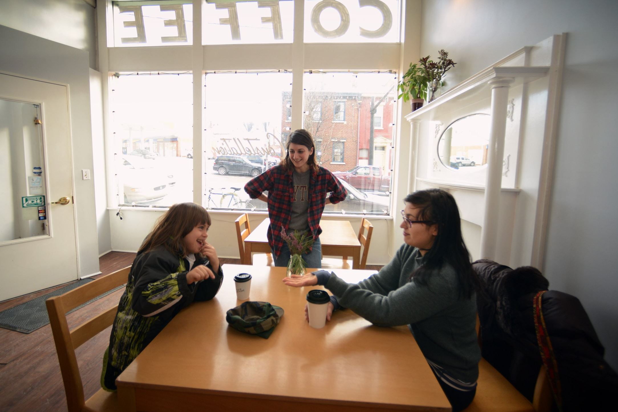 Constellation Coffe Amy Weiland, center, owner of Constellation Coffee, 4059 Penn Ave. in Lawrenceville, talks with Nikolai Pridannikov, left, and his mother, Nina Segreti of Highland Park, who stopped in for some hot drinks.