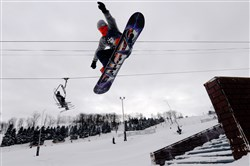 A snowboarder on the Streets Terrain Park on the front face of Seven Springs Wednesday.