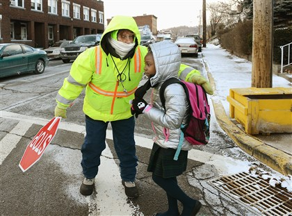 20140106radColdWeatherLocal04-3D-1 Crossing guard Barbara O'Toole shepherds her charges at the intersection of Broadway and Third St. in McKees Rocks as the wind chill hits minus five degrees on Monday January 6.