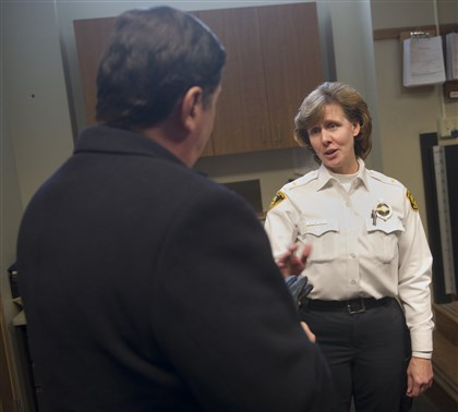 20140108rldPedutoPolicePresser02-1 City police Lt. Lori McCartney speaks with Mayor Bill Peduto on Wednesday before the mayor's news conference at the Zone 3 station in Allentown.