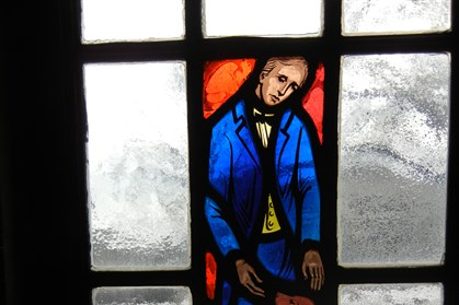 20140109lbStephenFoster1 An image of composer Stephen Foster, who died 150 years ago today, is captured in stained glass in one of the windows in the Stephen Foster Memorial Museum at the University of Pittsburgh.