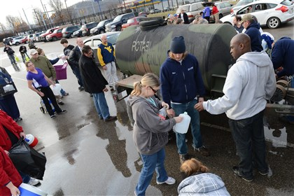 20140110charleston2 West Virginia American Water customers line up for water at the Gestamp Plant after waiting hours for a water truck, only to have it emptied in about 20 minutes Friday in South Charleston, W.Va.