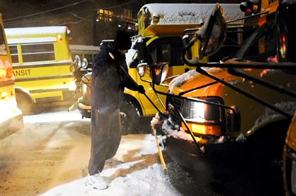 "9lm00kkv-14 ""Slim"" Forsythe cleans the snow off his school bus before dawn Dec. 17. To pay the bills, Mr. Forsythe works as a school bus driver. Every morning and every evening, he walks across the 62nd Street Bridge to Etna, where he picks up his bus."