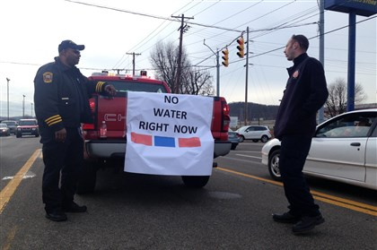 2014 South Charleston firefighters wait for water South Charleston Fire and Rescue Division Assistant Chief Virgil White and firefighter Jeff Kessler stand in the middle of Maccorkle Avenue in South Charleston, W.Va., waiting for another batch of water to come in to a distribution center on Friday. Many drivers slowed and rolled down the window to ask the firefighters when they could expect the next tanker.