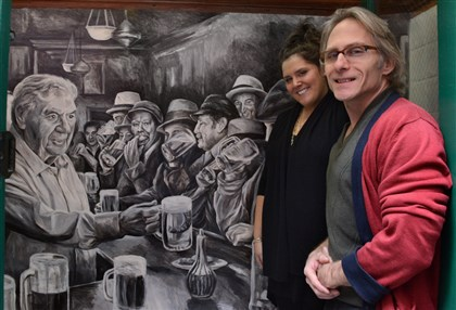Oyster House mural artist Artist Ken Heusey with Jen Grippo, at the Original Oyster House where Mr. Huesey's mural of the bar is just inside the side door.