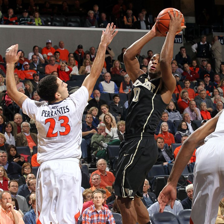 Wake1 Wake Forest guard Codi Miller-McIntyre shoots next to Virginia guard London Perrantes during a game Wednesday in Charlottesville, Va.