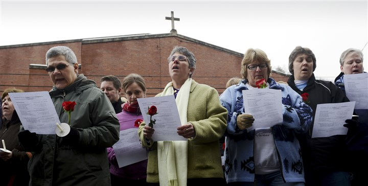 20140110 Prayer rally for Aliquippa nun 2 Sister Mary Pellegrino, center, of the Sisters of St. Joseph of Baden, is among about 200 participants sing inghymns during a rally at St. Titus Church in Aliquippa on Friday.