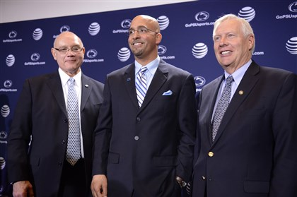 cook0112 New Penn State coach James Franklin, center, poses with athletic director David Joyner, left, and Penn State president Rodney Erickson after being introduced at a news conference Saturday.