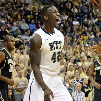 20140111mfpittsports03-1 Panther forward Talib Zanna celebrates after dunking against Wake Forest in the first half at the Petersen Events Center.