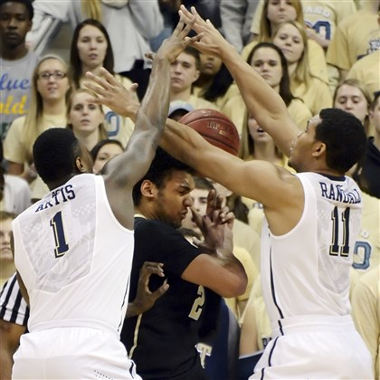 Jamel Artis and Derrick Randall Pitt's Jamel Artis and Derrick Randall defend Wake Forest's Devin Thomas in the first half at the Petersen Events Center Jan. 11.