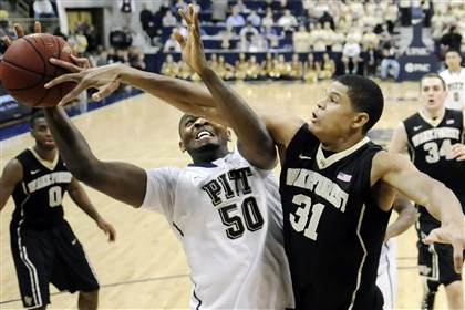 20140111mfpittsports10-7 Pitt's Joseph Uchebo drives to the net against Wake Forest's Andre Washington in the second half at the Petersen Events Center Jan. 11.
