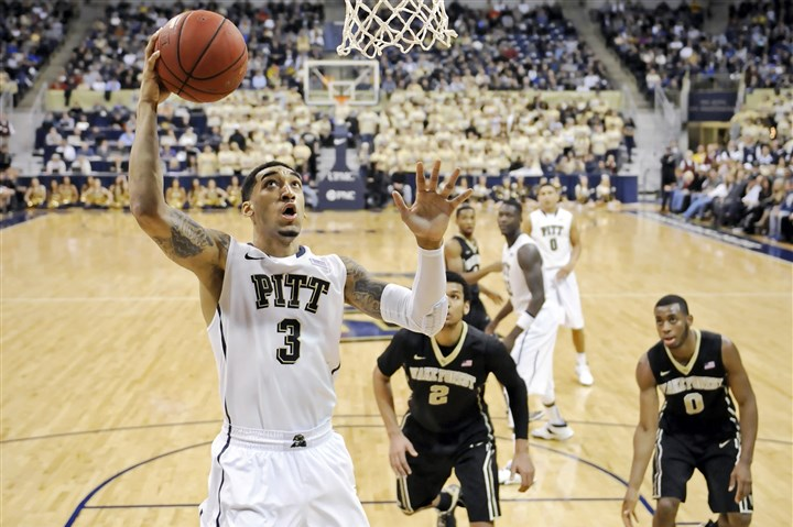 20140111mfpittsports11-9 Pitt's Cameron Wright lays the ball up against Wake Forest in the second half Saturday at Petersen Events Center.