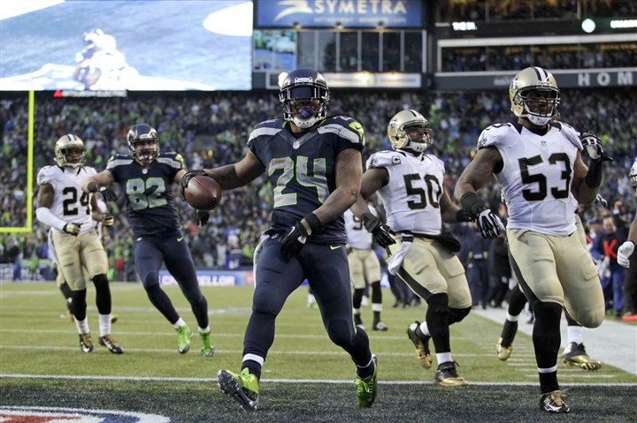 Marshawn Lynch Seattle Seahawks running back Marshawn Lynch arrives in the end zone with a 31-yard touchdown during the fourth quarter of an NFC divisional playoff game against the New Orleans Saints in Seattle, Saturday, Jan. 11, 2014.