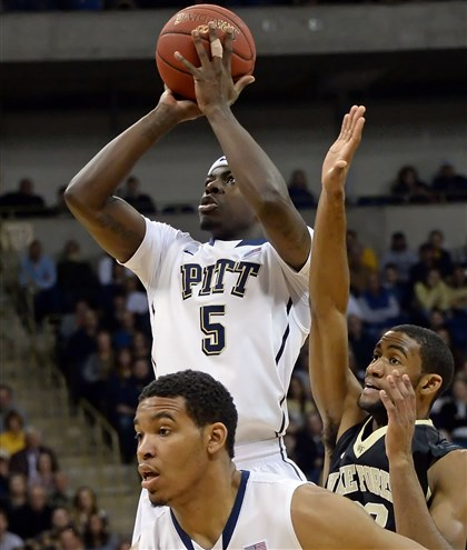 20140112mfjohnsonsports02-1 Pitt's Durand Johnson (5) takes a shot Saturday against Wake Forest at Petersen Events Center. He left the floor after he was injured later in the game and will miss the rest of this season.