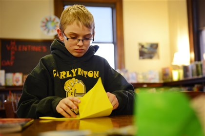 Rory Dougherty Rory Dougherty, 12, of Carnegie folds origami Monday afternoon at the Carnegie Library in Carnegie.