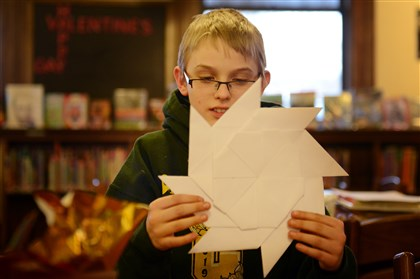 "Rory Dougherty Rory Dougherty, 12, of Carnegie shows off his ""transforming Ninja star Frisbee"" Monday afternoon at the Carnegie Library in Carnegie."