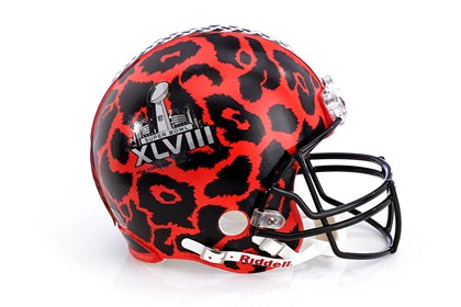 Diane von Furstenberg-designed helmet Diane von Furstenberg's NFL helmet for the auction features an animal print.