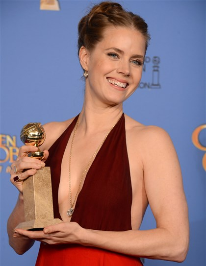 "Amy Adams at 2014 Golden Globes Amy Adams with award for best actress in a motion picture -- comedy or musical for ""American Hustle"" at the 71st annual Golden Globe Awards."