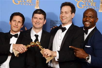 """Brooklyn Nine-Nine"" at Golden Globes From left, Andy Samberg, Michael Schur, Dan Goor and Terry Crews pose in the press room with the award for best television series -- comedy or musical for ""Brooklyn Nine - Nine"" at the 71st annual Golden Globe Awards."