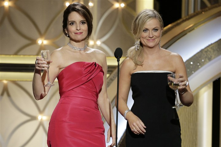 Tina Fey, Amy Poehler at Golden Globes Tina Fey, left, and Amy Poehler host the 71st annual Golden Globe Awards at the Beverly Hilton Hotel on Sunday.