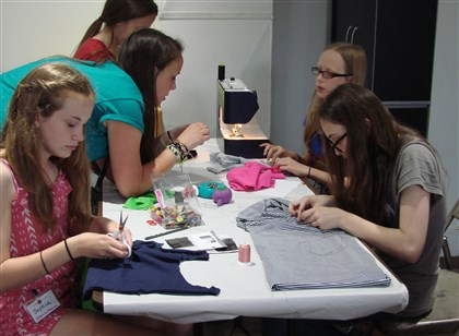 "20140114hoTalkAboutArt2mag Students can learn to design and sew clothes and accessories in the class ""Sewing Funda­mentals"" at Pittsburgh Center for the Arts in Shadyside."