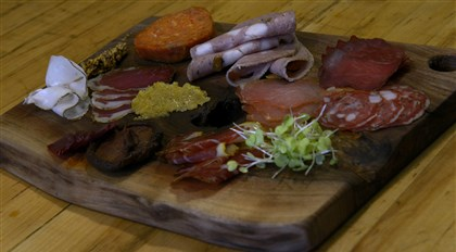 20140111ppNtable2WKNDMAG-1 Kevin Costa goes from butcher to restauranteur with the opening of the Crested Duck in Beechview featuring charcuterie. Shown is a selection of his cured meats that will be available at four Giant Eagle Market District locations.