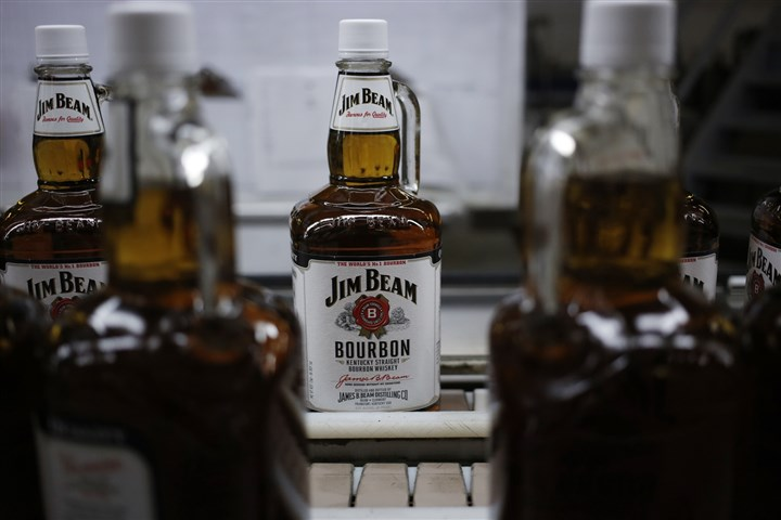 462501025 Bottles of Jim Beam Bourbon make their way down a conveyor belt inside the bottling plant at the Jim Beam Bourbon Distillery on Monday in Clermont, Ky.