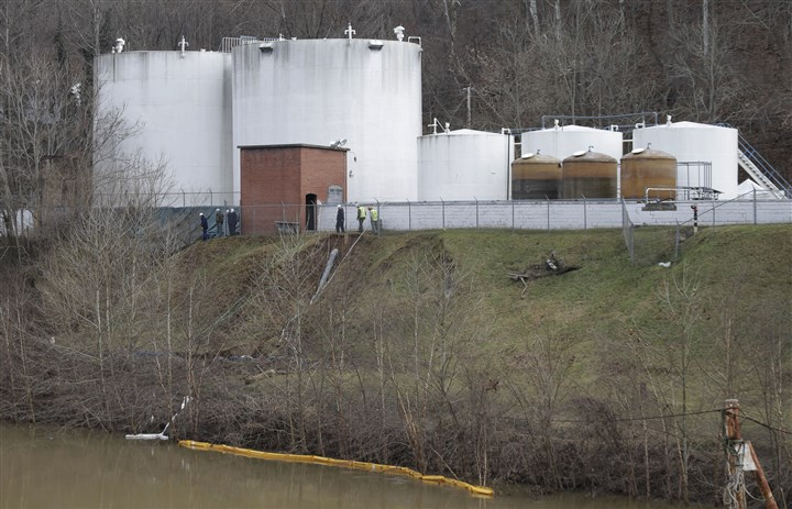 Chemical Spill West Virginia Workers in January inspect an area outside a retaining wall around storage tanks where a chemical leaked into the Elk River at Freedom Industries storage facility in Charleston, W.Va.