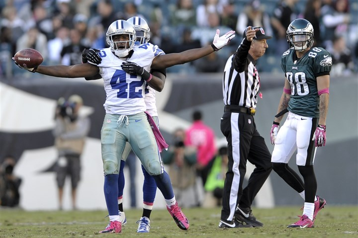 2013 Barry Church 03 Dallas Cowboys Morris Claiborne hugs free safety Barry Church (42) after Church intercepted a pass during the second half Oct. 20 in Philadelphia.