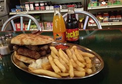 Cevapi platter with Slovenian soft drinks at Fredo's Deli, Dormont.