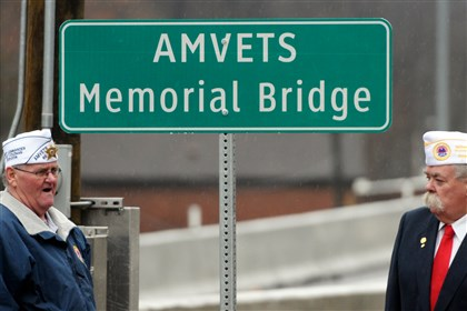 bridge amvets Colt Coleman, state commander of AMVETS Post 60, speaks at the dedication of the AMVETS Memorial Bridge in North Braddock, with Reg Riley, past state commander.
