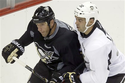 Penguins camp, Scuderi and Letourneau-Leblond Rob Scuderi, left, skates beside Pierre-Luc Letourneau-Leblond at practice in September.