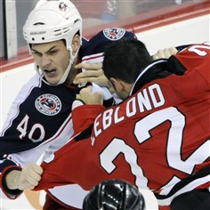 Letourneau-Leblond with NJ Devils New Jersey Devils' Pierre-Luc Letourneau-Leblond, right, fights with Columbus Blue Jackets' Jared Boll during a game in 2010 in Newark, N.J.