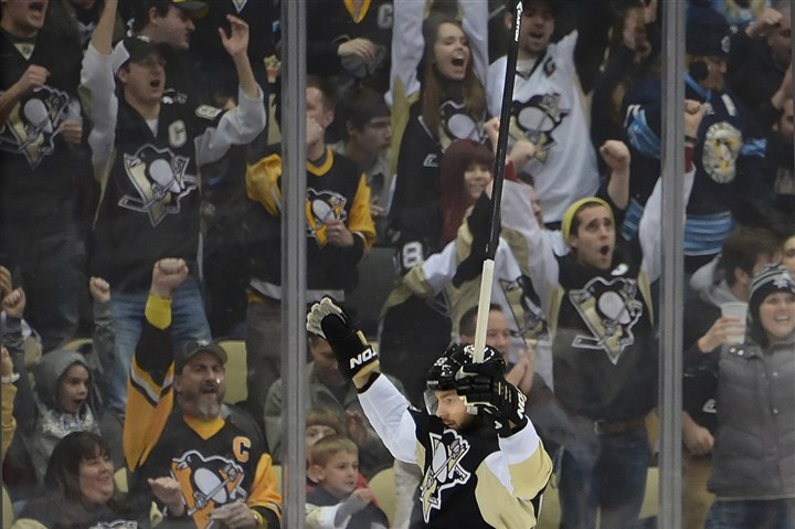 20140115pdPenguinsSports04-1 Penguins Kris Letang celebrates a goal against the Capitals.