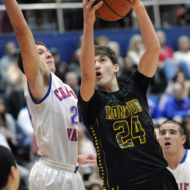 20141203JHSportsHSBB07.jpg Despite the efforts of Chartiers Valley's Joe Antonucci, left, Montour's Dustin Sleva goes to the hoop for a basket.