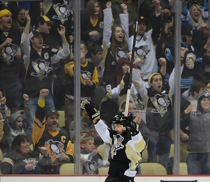 20140115pdPenguinsSports04-1 Penguins defenseman Kris Letang celebrates a goal earlier this season.