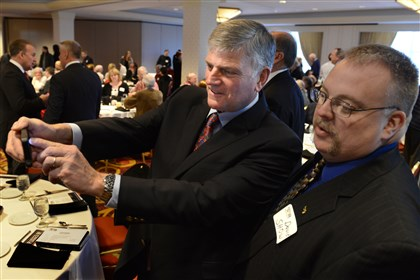 20140117dsGraham01 The Rev. Franklin Graham takes a selfie with David Show of Uniontown, before a luncheon at Thursday the Marriott City Center. The luncheon was part of the planning events for Rev. Graham's Three Rivers Festival of Hope, slated for Aug. 15-17.