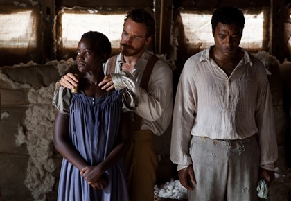 "Slave Lupita Nyong'o as ""Patsey,"" Michael Fassbender as ""Edwin Epps,"" and Chiwetel Ejiofor as ""Solomon Northup"" in ""12 Years a Slave."""