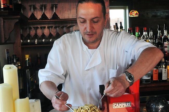 Chef Michele Savoia at Dish Osteria on South 17th Street prepares spahgetti with bottarga in 2014.