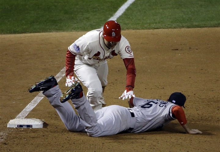 World Series Red Sox Cardinals Baseball St. Louis Cardinals' Allen Craig gets tangled with Boston Red Sox's Will Middlebrooks during the ninth inning of Game 3 of baseball's World Series. Middlebrooks was called for obstruction on the play and Craig went in to score the game-winning run.